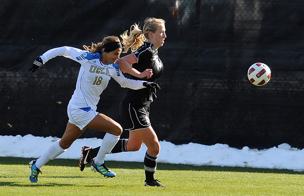 """Ally Courtnall, left, of UCLA, and Lizzy Herzl of CU, chase down the ball.<br /> For more photos of the game, go to  <a href=""""http://www.dailycamera.com"""">http://www.dailycamera.com</a>.<br /> Cliff Grassmick / October 28, 2011"""