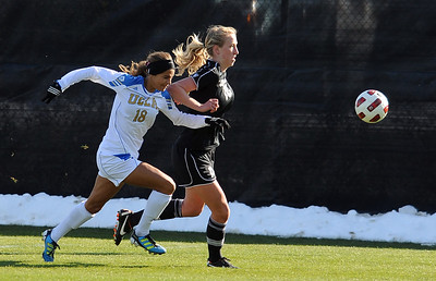 Ally Courtnall, left, of UCLA, and Lizzy Herzl of CU, chase down the ball. For more photos of the game, go to www.dailycamera.com. Cliff Grassmick / October 28, 2011