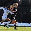 "Ally Courtnall, left, of UCLA, and Lizzy Herzl of CU, chase down the ball.<br /> For more photos of the game, go to  <a href=""http://www.dailycamera.com"">http://www.dailycamera.com</a>.<br /> Cliff Grassmick / October 28, 2011"