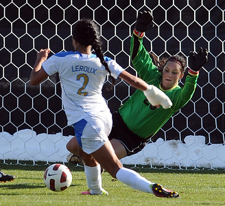 Sydney Leroux of UCLA, tries to score of her goals past Kayla Millar of CU. For more photos of the game, go to www.dailycamera.com. Cliff Grassmick / October 28, 2011