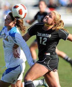 Chelsea Stewart, left, of UCLA, and Carly Bolyard of CU, battle for the ball. For more photos of the game, go to www.dailycamera.com. Cliff Grassmick / October 28, 2011