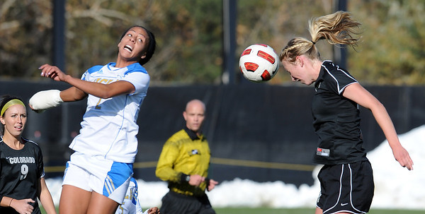 """Sydney Leroux, left, of UCLA, and Lizzy Herzl of CU, get up in the air to hit the ball.<br /> For more photos of the game, go to  <a href=""""http://www.dailycamera.com"""">http://www.dailycamera.com</a>.<br /> Cliff Grassmick / October 28, 2011"""