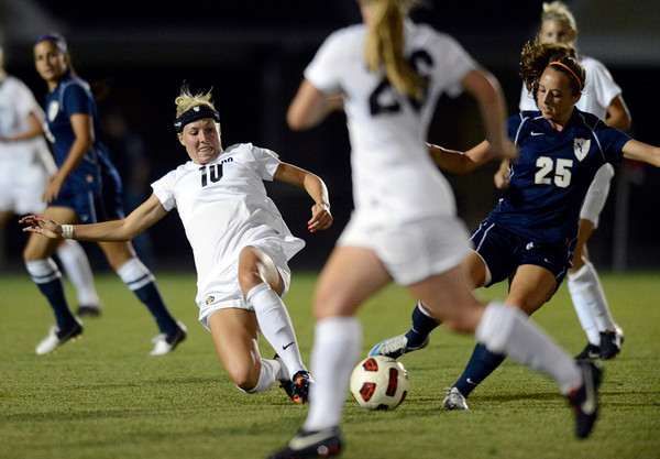 University of Colorado's Amy Barczuk, No. 10, goes for a slide tackle on Brittany Dunn, No. 25, during a game against the University of Northern Colorado on Friday, Aug. 17, at Jackson Stadium in Greeley. CU won 3-0.<br /> Jeremy Papasso/ Camera