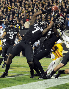 University of Colorado's Toney Clemons, No. 7, and Paul Richardson try to pull the ball in for a touchdown on Friday, Nov. 4, during a football game against the University of Southern California at Folsom Field on the CU campus in Boulder. The play was an incomplete pass. For more photos of the game go to www.dailycamera.com Jeremy Papasso/ Camera