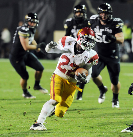 "Curtis McNeal of USC gets out in front of the Buffs.<br /> For more photos of CU and USC, go to  <a href=""http://www.dailycamera.com"">http://www.dailycamera.com</a>.<br /> November 4, 2011 / Cliff Grassmick"