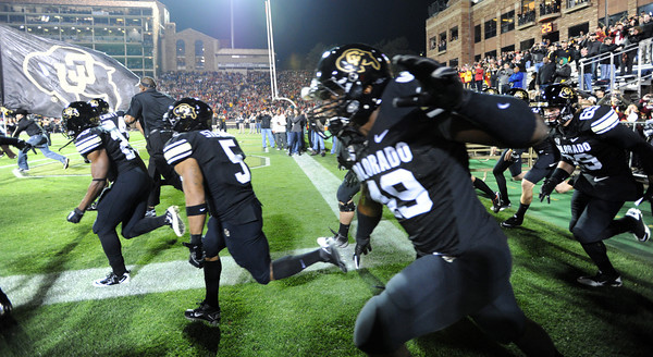 "The Buffs were all black against USC, including the helmets.<br /> For more photos of CU and USC, go to  <a href=""http://www.dailycamera.com"">http://www.dailycamera.com</a>.<br /> November 4, 2011 / Cliff Grassmick"