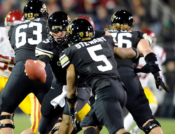 "University of Colorado's Tyler Hansen hands the ball off to Rodney Stewart on Friday, Nov. 4, during a football game against the University of Southern California at Folsom Field on the CU campus in Boulder. For more photos of the game go to  <a href=""http://www.dailycamera.com"">http://www.dailycamera.com</a><br /> Jeremy Papasso/ Camera"