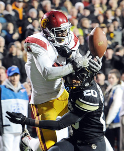 Marquise Lee of USC attempts  a catch past Greg Henderson of CU. Lee did not make the catch. For more photos of CU and USC, go to www.dailycamera.com. November 4, 2011 / Cliff Grassmick