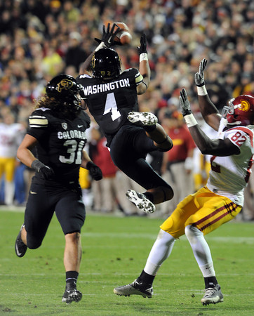 "Kyle Washington of CU broke up this pass but was hurt of the play.<br /> For more photos of CU and USC, go to  <a href=""http://www.dailycamera.com"">http://www.dailycamera.com</a>.<br /> November 4, 2011 / Cliff Grassmick"