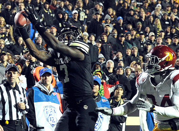 "University of Colorado's Toney Clemons catches a touchdown pass over Southern California's Tony Burnett on Friday, Nov. 4, during a football game against the University of Southern California at Folsom Field on the CU campus in Boulder. CU lost the game 42-17. For more photos of the game go to  <a href=""http://www.dailycamera.com"">http://www.dailycamera.com</a><br /> Jeremy Papasso/ Camera"