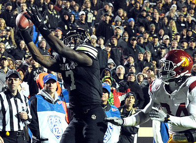 University of Colorado's Toney Clemons catches a touchdown pass over Southern California's Tony Burnett on Friday, Nov. 4, during a football game against the University of Southern California at Folsom Field on the CU campus in Boulder. CU lost the game 42-17. For more photos of the game go to www.dailycamera.com Jeremy Papasso/ Camera