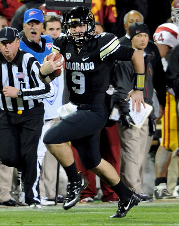 """Tyler Hansen scrambles for a big gain against USC.<br /> For more photos of CU and USC, go to  <a href=""""http://www.dailycamera.com"""">http://www.dailycamera.com</a>.<br /> November 4, 2011 / Cliff Grassmick"""