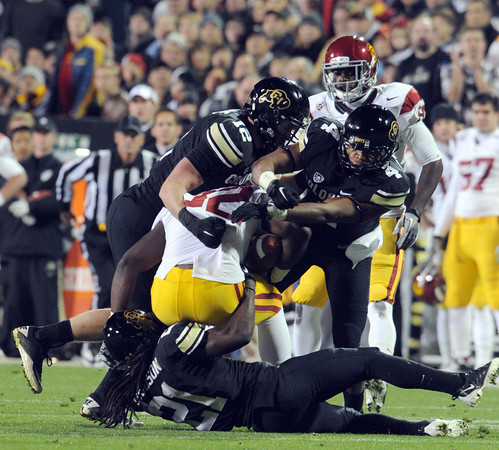 "Randell Telfer of USC is wrapped up by Patrick Mahnke and Kyle Washington, and D.D Goodson of CU.<br /> For more photos of CU and USC, go to  <a href=""http://www.dailycamera.com"">http://www.dailycamera.com</a>.<br /> November 4, 2011 / Cliff Grassmick"