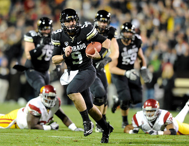 University of Colorado's Tyler Hansen rushes the ball towards the endzone on Friday, Nov. 4, during a football game against the University of Southern California at Folsom Field on the CU campus in Boulder. For more photos of the game go to www.dailycamera.com Jeremy Papasso/ Camera