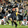 "University of Colorado's Tyler Hansen rushes the ball towards the endzone on Friday, Nov. 4, during a football game against the University of Southern California at Folsom Field on the CU campus in Boulder. For more photos of the game go to  <a href=""http://www.dailycamera.com"">http://www.dailycamera.com</a><br /> Jeremy Papasso/ Camera"