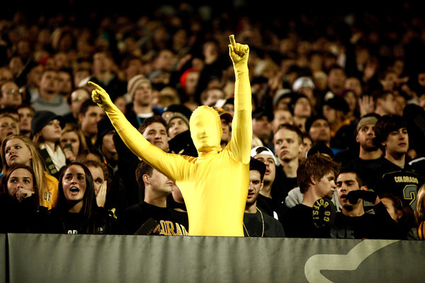Emilien Fritsch shows his pride at the University of Colorado vs. University of Southern California football game at Folson Field November 4.<br /> Photo by Chancey Bush