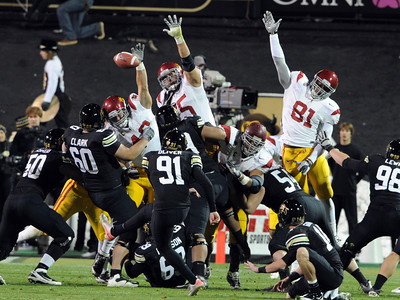 This CU field goal attempt by Will Oliver was one of two blocked by the Trojans. For more photos of CU and USC, go to www.dailycamera.com. November 4, 2011 / Cliff Grassmick