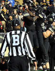 University of Colorado's Toney Clemons gets congratulated by teammates after scoring a touchdown on Friday, Nov. 4, during a football game against the University of Southern California at Folsom Field on the CU campus in Boulder. CU lost the game 42-17. For more photos of the game go to www.dailycamera.com Jeremy Papasso/ Camera