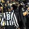 "University of Colorado's Toney Clemons gets congratulated by teammates after scoring a touchdown on Friday, Nov. 4, during a football game against the University of Southern California at Folsom Field on the CU campus in Boulder. CU lost the game 42-17. For more photos of the game go to  <a href=""http://www.dailycamera.com"">http://www.dailycamera.com</a><br /> Jeremy Papasso/ Camera"