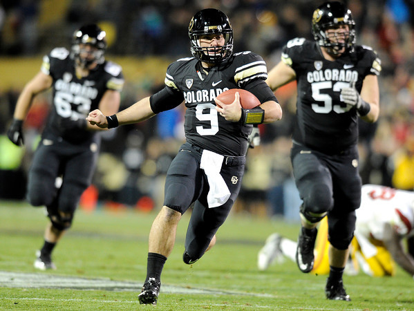 "University of Colorado's Tyler Hansen rushes the ball on Friday, Nov. 4, during a football game against the University of Southern California at Folsom Field on the CU campus in Boulder. For more photos of the game go to  <a href=""http://www.dailycamera.com"">http://www.dailycamera.com</a><br /> Jeremy Papasso/ Camera"