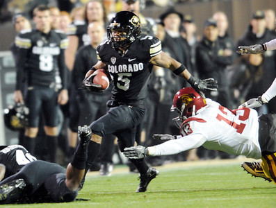 Rodney Stewart of CU gets past Tre Madden of USC. For more photos of CU and USC, go to www.dailycamera.com. November 4, 2011 / Cliff Grassmick