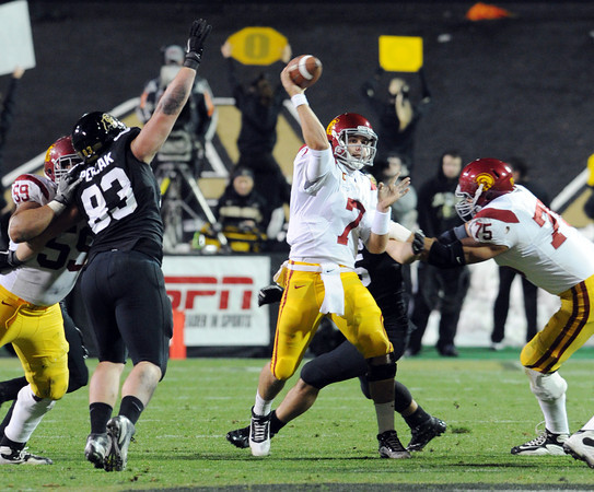 "Matt Barkley of USC, throws the ball down field against pressure of Will Pericak of CU.<br /> For more photos of CU and USC, go to  <a href=""http://www.dailycamera.com"">http://www.dailycamera.com</a>.<br /> November 4, 2011 / Cliff Grassmick"