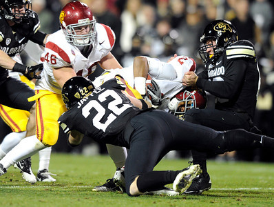 University of Colorado's Ryan Iverson, right,  tackles Southern California's Robert Woods on Friday, Nov. 4, during a football game against the University of Southern California at Folsom Field on the CU campus in Boulder. For more photos of the game go to www.dailycamera.com Jeremy Papasso/ Camera