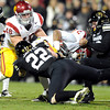 "University of Colorado's Ryan Iverson, right,  tackles Southern California's Robert Woods on Friday, Nov. 4, during a football game against the University of Southern California at Folsom Field on the CU campus in Boulder. For more photos of the game go to  <a href=""http://www.dailycamera.com"">http://www.dailycamera.com</a><br /> Jeremy Papasso/ Camera"