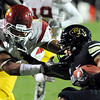 """Rodney Stewart of CU gets stopped for a loss by Nick Perry of USC.<br /> For more photos of CU and USC, go to  <a href=""""http://www.dailycamera.com"""">http://www.dailycamera.com</a>.<br /> November 4, 2011 / Cliff Grassmick"""