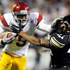 "University of Colorado's Terrel Smith gets stiff armed by Southern California's Marqise Lee on Friday, Nov. 4, during a football game against the University of Southern California at Folsom Field on the CU campus in Boulder. For more photos of the game go to  <a href=""http://www.dailycamera.com"">http://www.dailycamera.com</a><br /> Jeremy Papasso/ Camera"