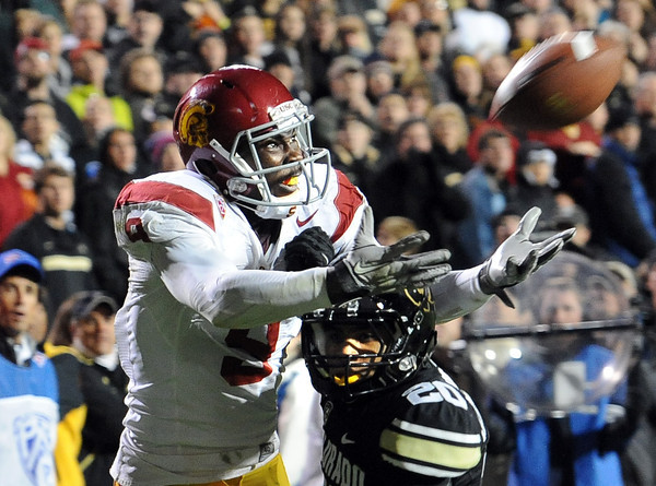 """Marquise Lee of USC stretches out for a catch past Greg Henderson of CU. Lee did not make the catch.<br /> For more photos of CU and USC, go to  <a href=""""http://www.dailycamera.com"""">http://www.dailycamera.com</a>.<br /> November 4, 2011 / Cliff Grassmick"""