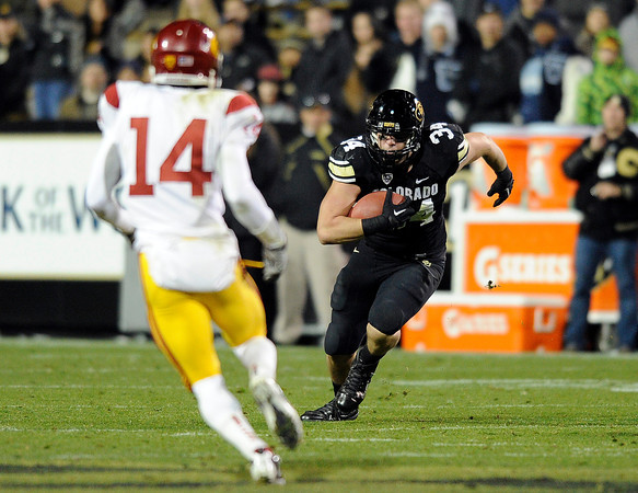 """University of Colorado's Ryan Deehan rushes the ball on Friday, Nov. 4, during a football game against the University of Southern California at Folsom Field on the CU campus in Boulder. CU lost the game 42-17. For more photos of the game go to  <a href=""""http://www.dailycamera.com"""">http://www.dailycamera.com</a><br /> Jeremy Papasso/ Camera"""