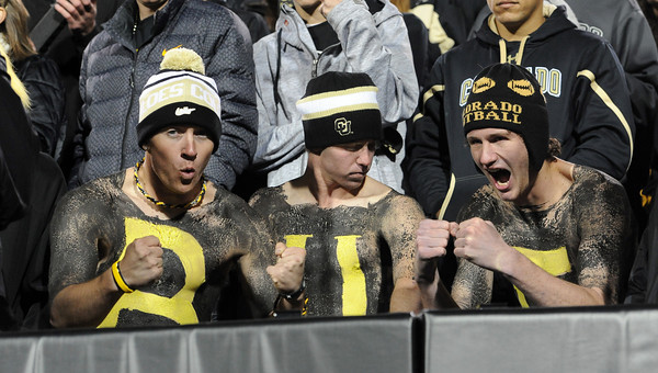 """Billy Cox, Max Demby and Conrad Sclar, show there true colors during the CU USC game.<br /> For more photos of CU and USC, go to  <a href=""""http://www.dailycamera.com"""">http://www.dailycamera.com</a>.<br /> November 4, 2011 / Cliff Grassmick"""