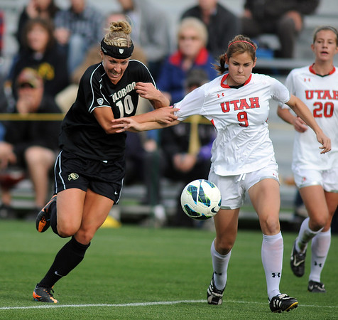 "Amy Barczuk, left of CU, and Monica Okapal of Utah, chase down a ball during the game on Friday.<br /> For more photos from the game, go to  <a href=""http://www.dailycamera.com"">http://www.dailycamera.com</a>..<br />  Cliff Grassmick / November 2, 2012"