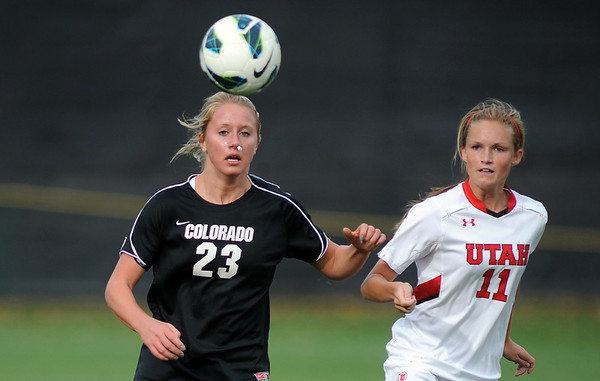 "Anne Stuller, left, of CU, and Avery Ford, of Utah chase down a ball on Friday.<br /> For more photos from the game, go to  <a href=""http://www.dailycamera.com"">http://www.dailycamera.com</a>..<br />  Cliff Grassmick / November 2, 2012"