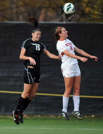 "Heather Ward, left, of CU, and Kaycee Buckley of Utah on the header.<br /> For more photos from the game, go to  <a href=""http://www.dailycamera.com"">http://www.dailycamera.com</a>..<br />  Cliff Grassmick / November 2, 2012"