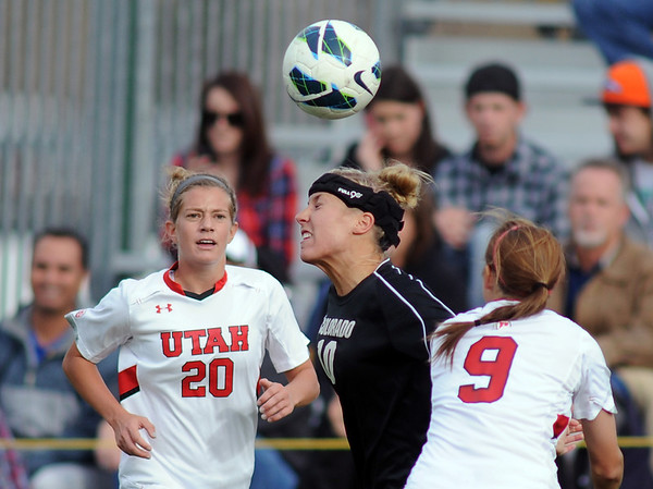 "Amy Barczuk of CU connects with the ball in front of Jenny Hutton of Utah.<br /> For more photos from the game, go to  <a href=""http://www.dailycamera.com"">http://www.dailycamera.com</a>..<br />  Cliff Grassmick / November 2, 2012"