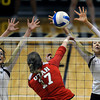 "University of Colorado's Nicole Edelman, left, and Kelsey English block a kill from Erin Redd during a game against the University of Utah on Wednesday, Sept. 19, at the Coors Event Center in Boulder. For more photos of the game go to  <a href=""http://www.dailycamera.com"">http://www.dailycamera.com</a><br /> Jeremy Papasso/ Camera"