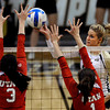 "University of Colorado's Nikki Lindow lobs the ball over the hands of Bailey Bateman, left, and McKenzie Odale for a point during a game against the University of Utah on Wednesday, Sept. 19, at the Coors Event Center in Boulder. For more photos of the game go to  <a href=""http://www.dailycamera.com"">http://www.dailycamera.com</a><br /> Jeremy Papasso/ Camera"