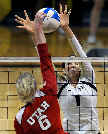 """University of Colorado's Kelsey English blocks a kill from Morgan Odale during a game against the University of Utah on Wednesday, Sept. 19, at the Coors Event Center in Boulder. For more photos of the game go to  <a href=""""http://www.dailycamera.com"""">http://www.dailycamera.com</a><br /> Jeremy Papasso/ Camera"""