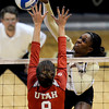 "University of Colorado's Alexis Austin goes for a kill over Alli Spurrier during a game against the University of Utah on Wednesday, Sept. 19, at the Coors Event Center in Boulder. For more photos of the game go to  <a href=""http://www.dailycamera.com"">http://www.dailycamera.com</a><br /> Jeremy Papasso/ Camera"