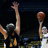 "University of Colorado's Lexy Kresl drains a three-pointer over Valparaiso's Tabitha Gerardot on Friday, Nov. 25, during a basketball game against Valparaiso University at the Coors Event Center on the CU campus in Boulder. For more photos of the game go to  <a href=""http://www.dailycamera.com"">http://www.dailycamera.com</a><br /> Photo by Jeremy Papasso"