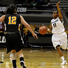 "University of Colorado's Brittany Wilson motions the offense on Friday, Nov. 25, during a basketball game against Valparaiso University at the Coors Event Center on the CU campus in Boulder. For more photos of the game go to  <a href=""http://www.dailycamera.com"">http://www.dailycamera.com</a><br /> Photo by Jeremy Papasso"