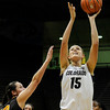 "University of Colorado's Julie Seabrook takes a shot over Valparaiso's Laura Richards on Friday, Nov. 25, during a basketball game against Valparaiso University at the Coors Event Center on the CU campus in Boulder. For more photos of the game go to  <a href=""http://www.dailycamera.com"">http://www.dailycamera.com</a><br /> Photo by Jeremy Papasso"