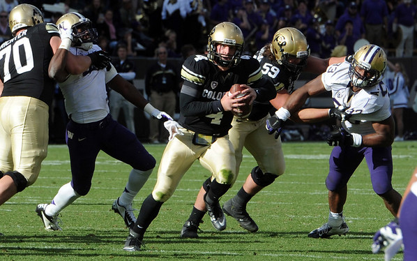 "Jordan Webb of CU scrambles to find a receiver against Washington on Saturday.<br /> For more photos of the CU game, go to  <a href=""http://www.dailycamera.com"">http://www.dailycamera.com</a><br /> Cliff Grassmick / November 17, 2012"