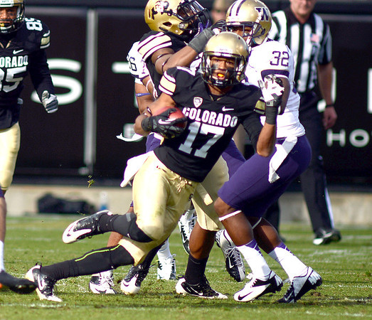 "Marques Mosley of CU runs back a kick off for a huge gain against Washington.<br /> For more photos of the CU game, go to  <a href=""http://www.dailycamera.com"">http://www.dailycamera.com</a><br /> Cliff Grassmick / November 17, 2012"