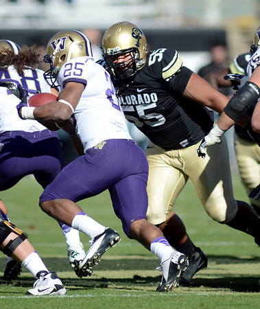"Josh Tupou of CU has his eyes on Bishop Sankey of Washington.<br /> For more photos of the CU game, go to  <a href=""http://www.dailycamera.com"">http://www.dailycamera.com</a><br /> Cliff Grassmick / November 17, 2012"