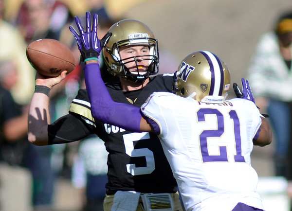 "Connor Wood of CU throws an interception on this play after being pressured by Marcus Peters of Washington.<br /> For more photos of the CU game, go to  <a href=""http://www.dailycamera.com"">http://www.dailycamera.com</a><br /> Cliff Grassmick / November 17, 2012"
