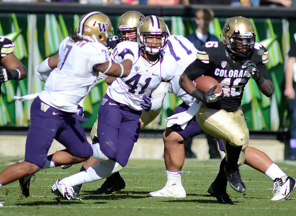 "Christian Powell of CU gets extra yards against Washington.<br /> For more photos of the CU game, go to  <a href=""http://www.dailycamera.com"">http://www.dailycamera.com</a><br /> Cliff Grassmick / November 17, 2012"