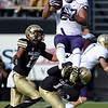"Austin Seferian-Jenkins of Washington goes up high for a catch and is hit by Parker Orms of CU.<br /> For more photos of the CU game, go to  <a href=""http://www.dailycamera.com"">http://www.dailycamera.com</a><br /> Cliff Grassmick / November 17, 2012"